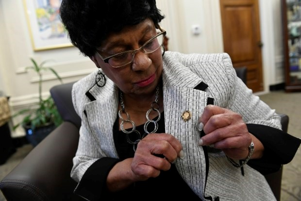 Albertine Sellers shows off her service pin for 60 years of working for the City of Denver on March 9, 2017 in Denver.